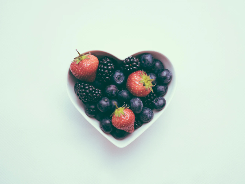 heart shaped bowl containing edible berries